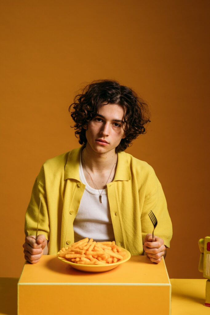 man with food in front of him